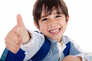 Boy showing like sign